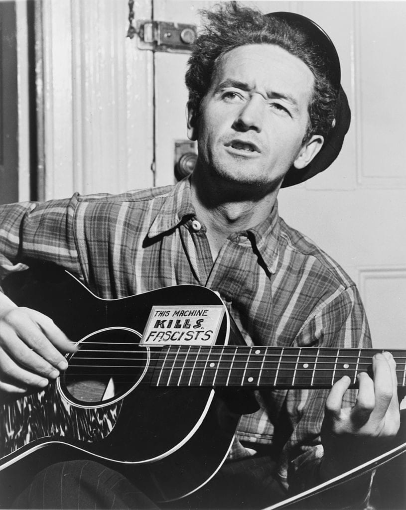 Name Area Schools After Woody Guthrie